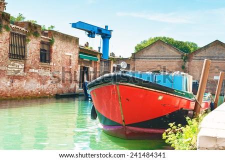 Old boat in Venice Italy. - stock photo