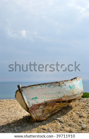 Old boat on beach - stock photo