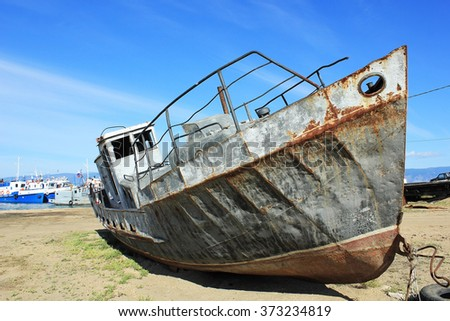 old boat on lake Baikal - stock photo