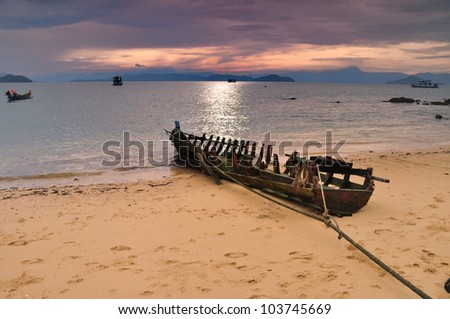 Old boat on the seashore. - stock photo