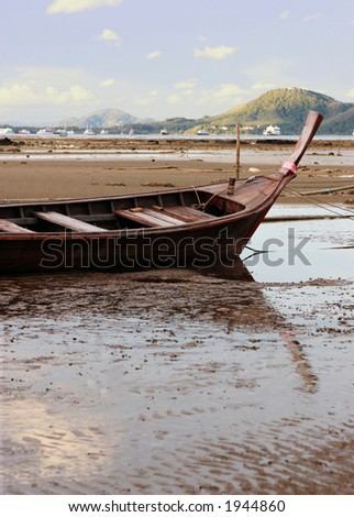 Old boat sitting on the sand when the tide is out