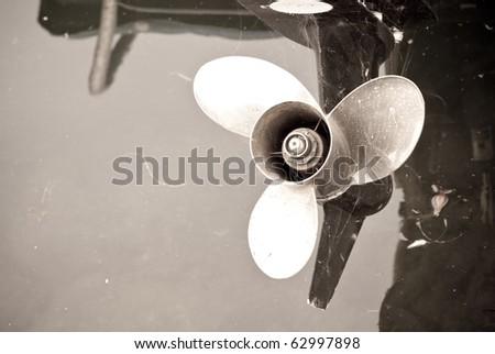 Old Boat Three Bladed Motor - stock photo