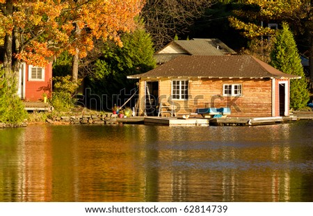 Old boathouse in the evening light - stock photo