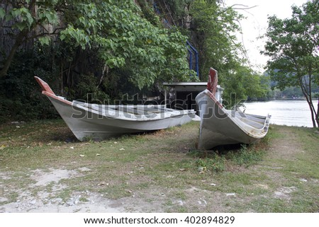 Old boats abandoned by the lake - stock photo