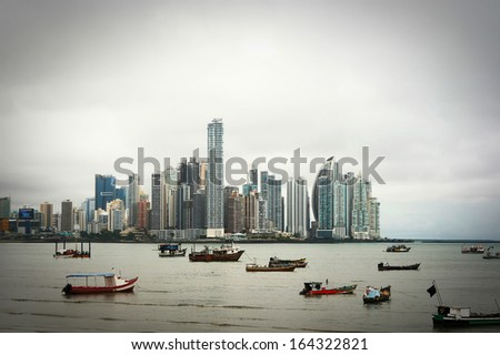 Old boats at Modern City. Panama City view. - stock photo