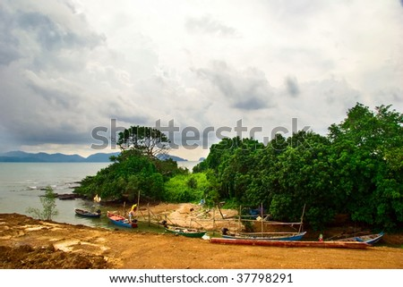 Old boats in gulf of Siam in bad weather. Thailand - stock photo