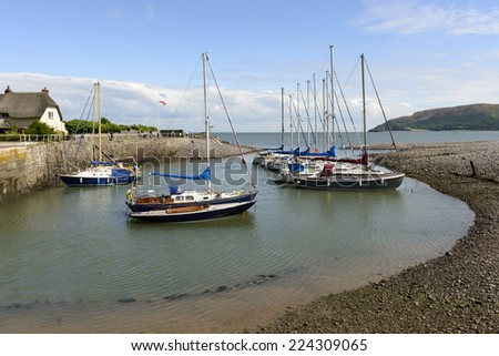 old boats moored in little bay at Porlock Weir, Somerset view of old boats moored in little bay near the horbur of historic touristic village of  Somerset. Shot in bright light  - stock photo