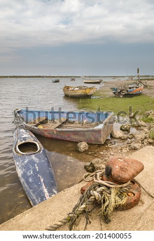 Old Boats on the quayside at Brancaster Staithe - stock photo