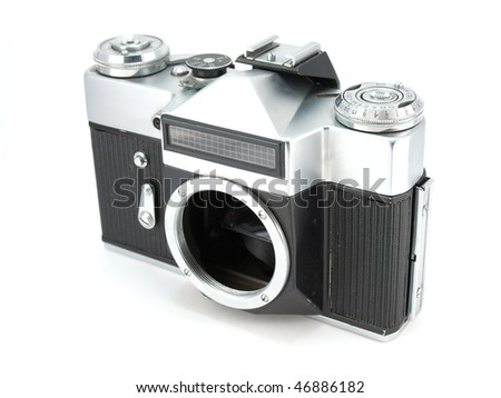 Old Body of SLR-camera over white - stock photo