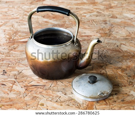 Old boil water, on wooden table - stock photo