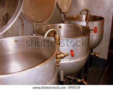 Old Boilers in the kitchen of the USS Constitution - stock photo