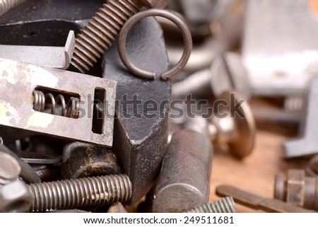 old bolts, screws and metal details, close up - stock photo