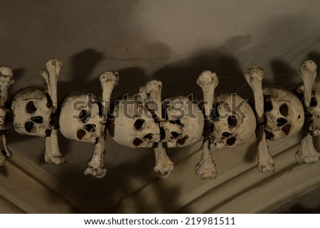 old bones and skulls in the Gothic vault of Kutna Hora. Ossuary.