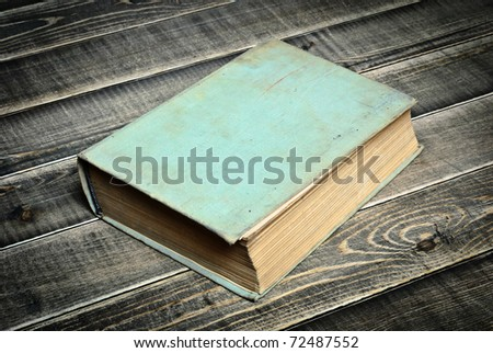 old book a on wooden table - stock photo