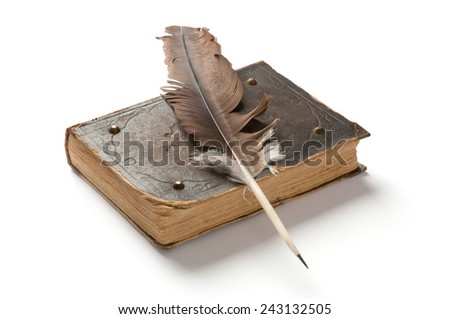 Old book and a fountain pen on white background - stock photo