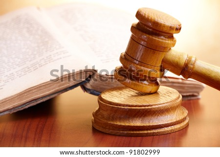Old book and gavel - stock photo