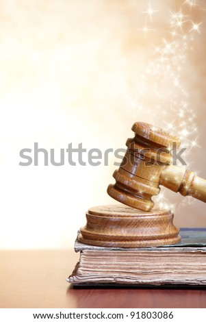 Old book and gavel with blank copy space for your text - stock photo