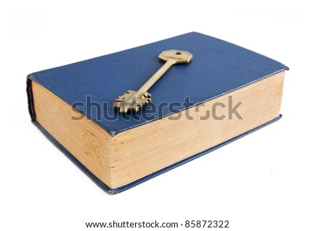 Old book and key isolated on white - stock photo