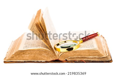 old book and magnifying glass isolated on white
