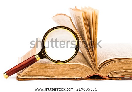 old book and magnifying glass isolated on white - stock photo