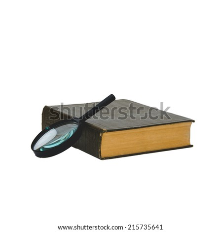 Old book and magnifying glass isolated white background - stock photo