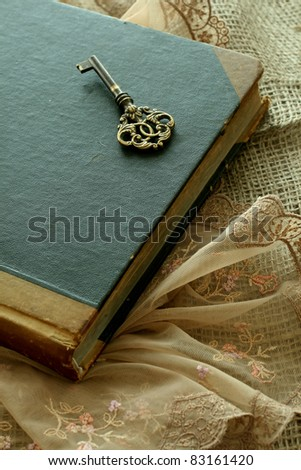 old book and old key - retro composition - stock photo
