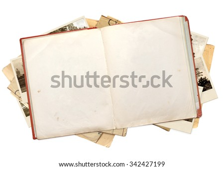 Old book and photos. Objects isolated on white background - stock photo