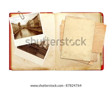 Old book and photos. Objects isolated over white
