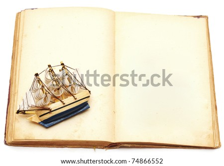 old book and ship on white background - stock photo
