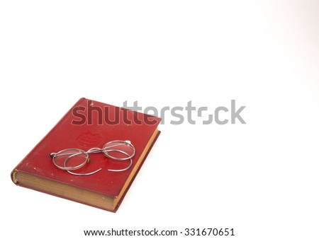 Old book and vintage glasses  isolated on white background  - stock photo