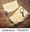Old book, compass and magnifying glass on wood background - stock photo