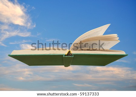 Old book flying on the sky - stock photo