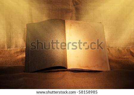 old book in evening ambient light - stock photo