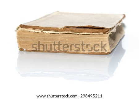 old book isolated on white reflective surface - stock photo
