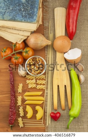 Old book of recipes for pasta. Recipe book. Homework pasta. The diet, according to cookbook. Vegetables and pasta. - stock photo