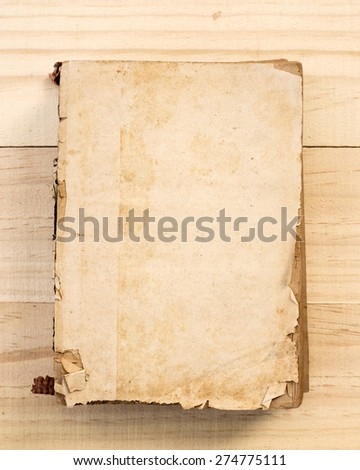 Old book on old wood. - stock photo