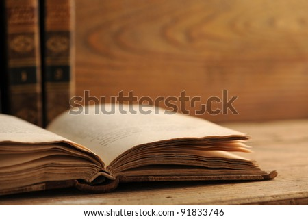 old book on the wooden table, similar photo in my portfolio