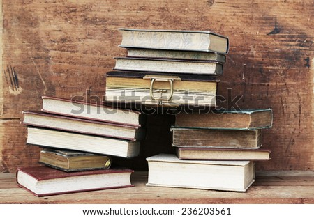 old book on wooden background.  - stock photo