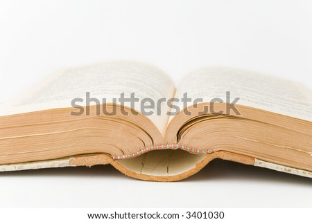 Old book open on a white background
