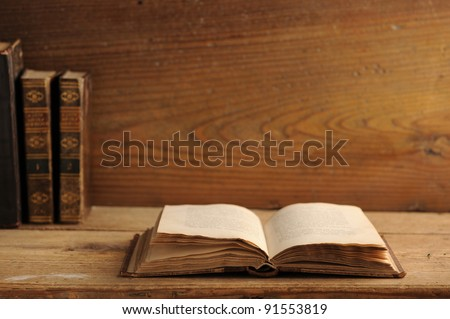 old book open on a wooden table - stock photo