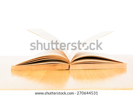 old book open on wooden table - stock photo