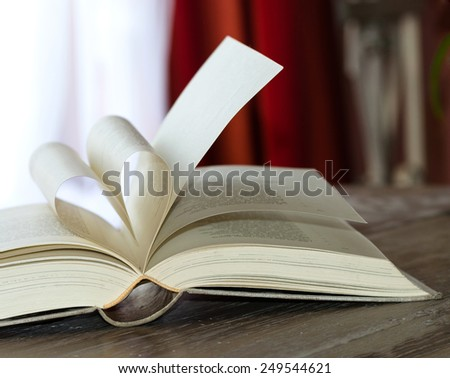 Old book page in heart shape  - stock photo