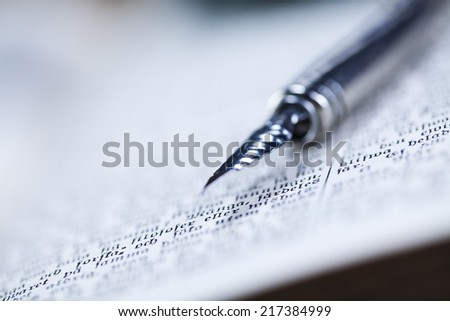 Old book, pen - stock photo