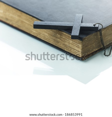 Old book with a cross on white background  - stock photo
