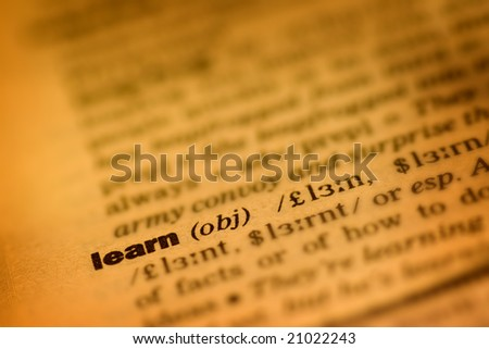"""Old book with """"learn"""" in focus , shallow DOF photo - stock photo"""