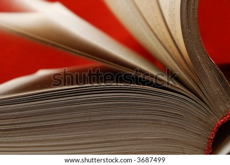 Old book with turning pages as a symbol of wisdom and knowledge - stock photo