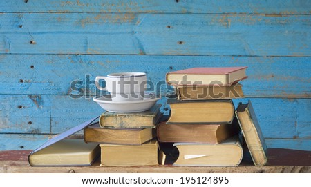 old books and cup of coffee, learning o. literature concept - stock photo