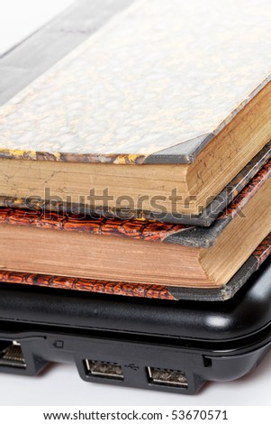old books and laptop on white background - stock photo