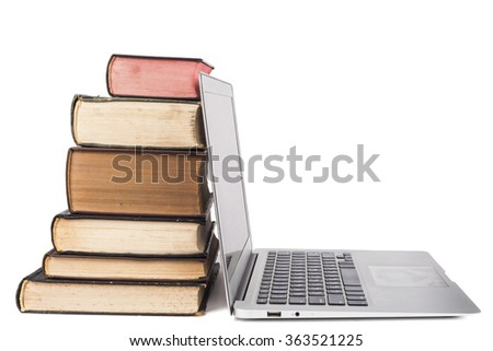 Old Books and silver laptop isolated on white background
