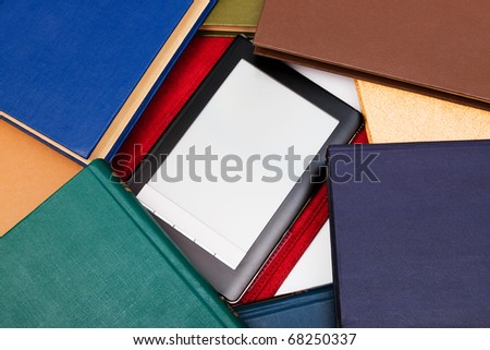old books and the modern reader a close-up - stock photo